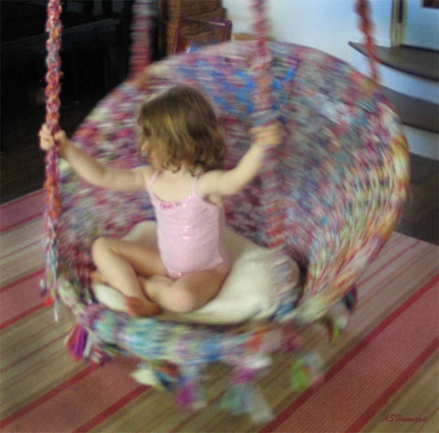 Sati loves spinning in her swing